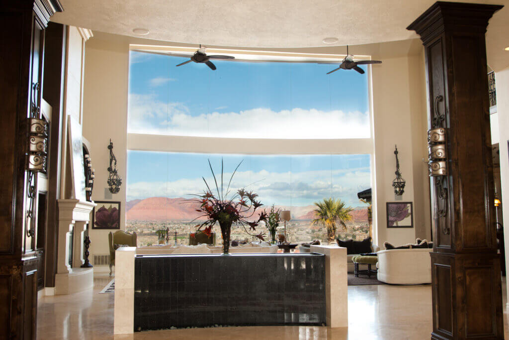Huge window overlooking red rock in St. George with modern furniture