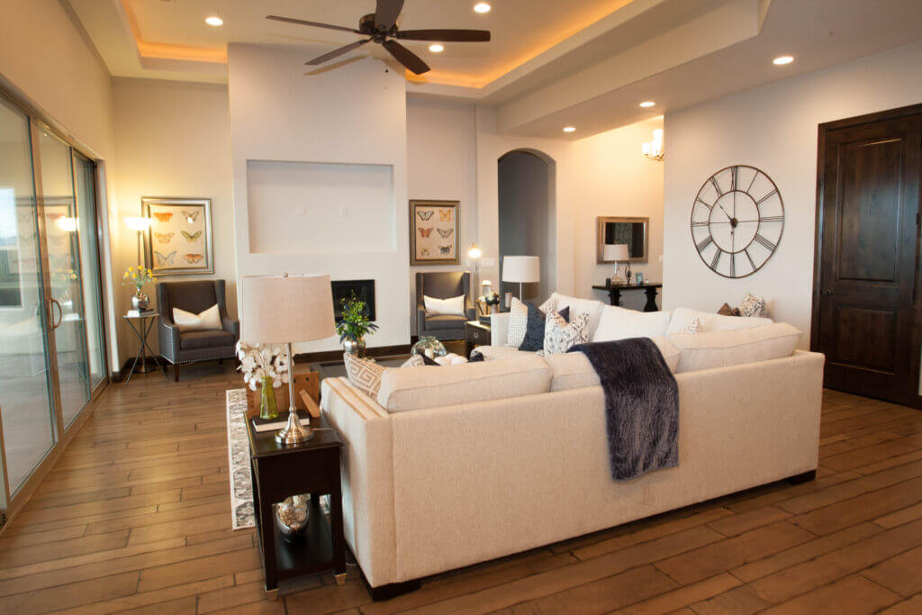 modern custom living room with white couch and ceiling fan in St. George Utah