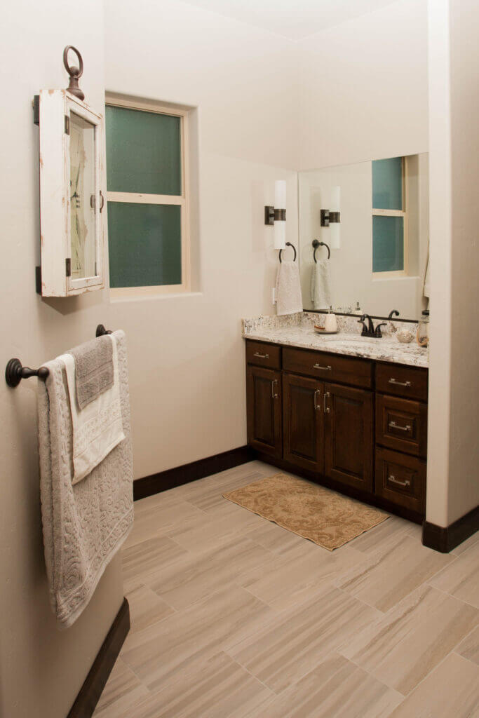 Half bath with dark cabinets in custom home in St. George