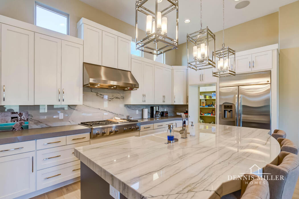 Kitchen with pendant lights and marble countertops in southern Utah custom home by St. George custom home builders DMH