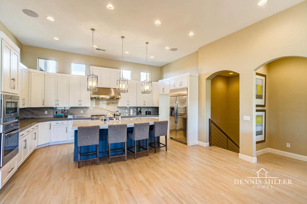 modern kitchen with wood floor & pendant lights in southern utah custom home
