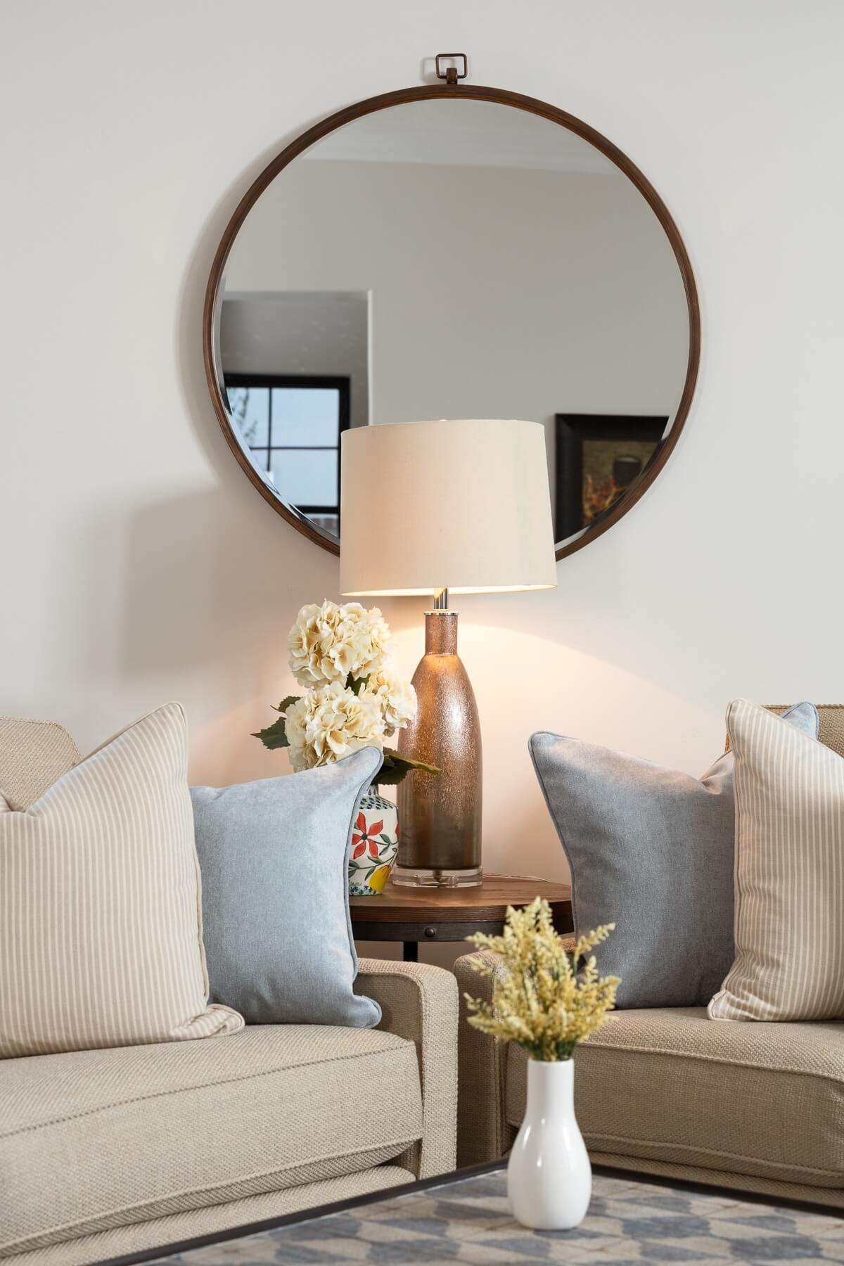Living Room Sofas with Accent Mirror - Home Design by Dennis Miller Homes