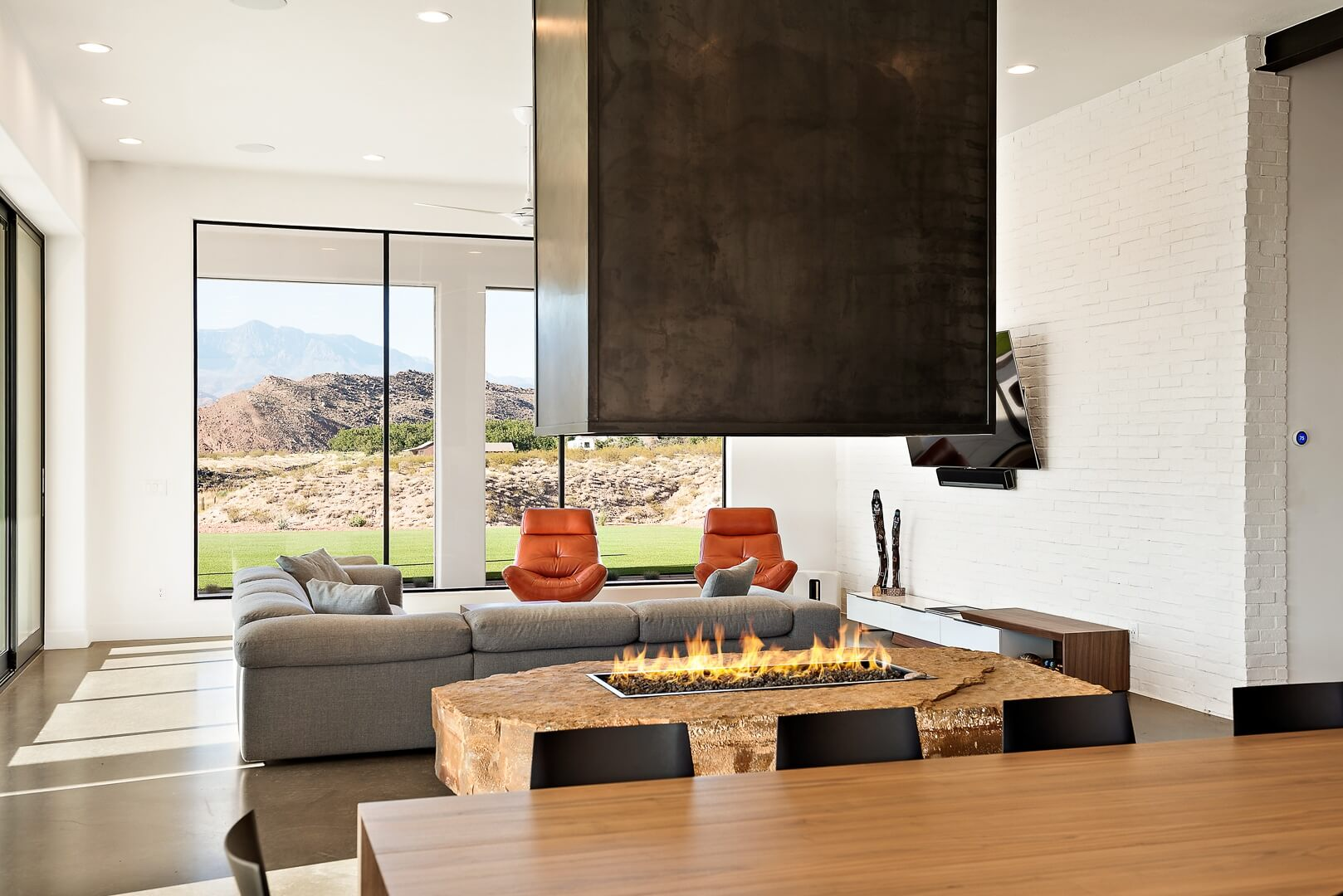 Luxury Living Room with Custom Indoor Fireplace and Dining Area - St. George Custom Home Design